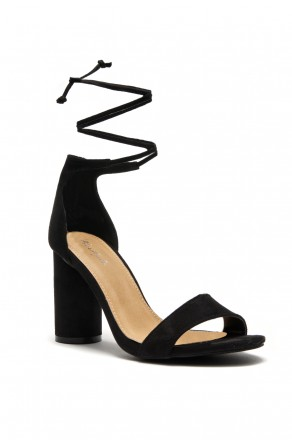 HerStyle Women's Manmade Imelida. Cylindrical heel with a petite bow at the ankle - Black